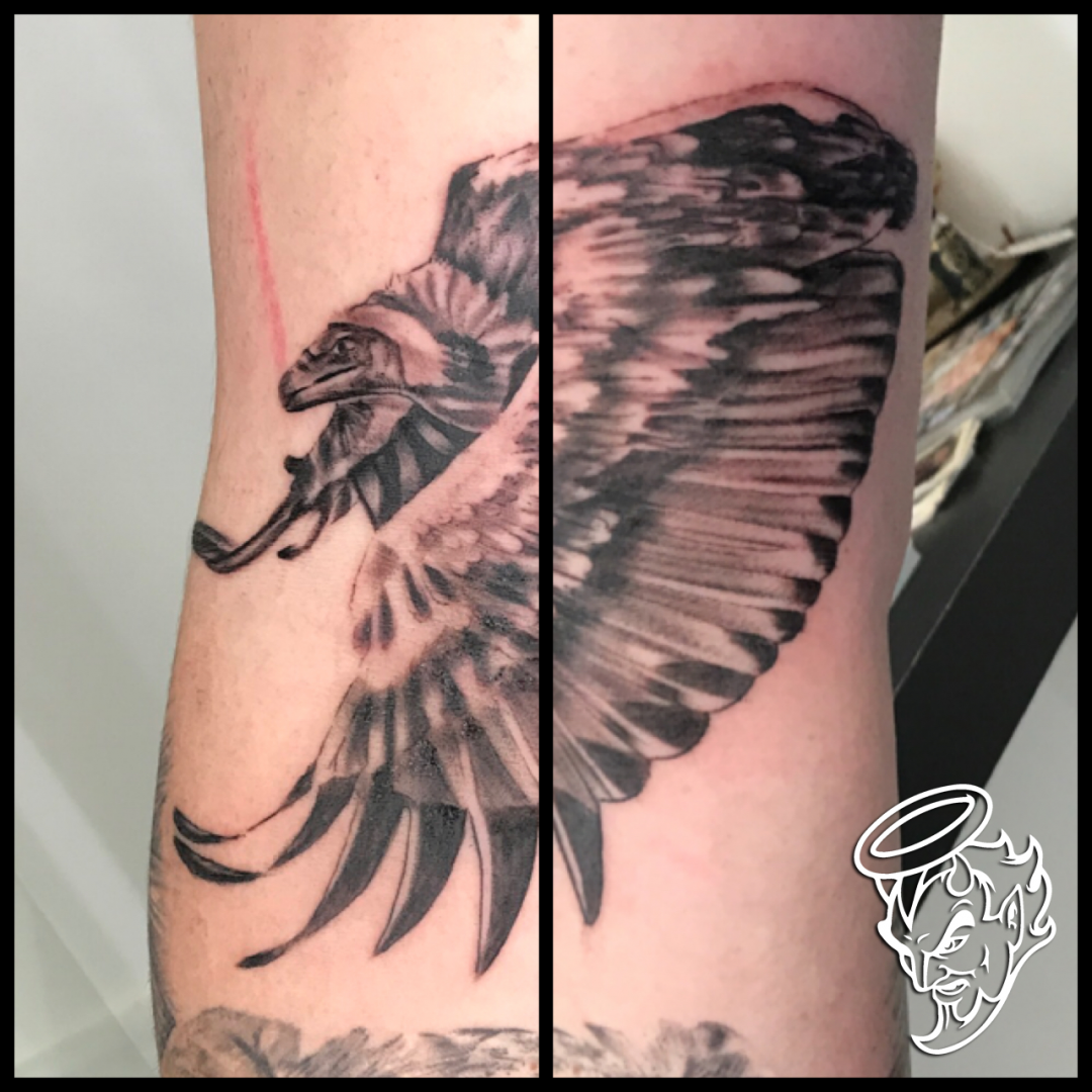 Flying vulture tattoo