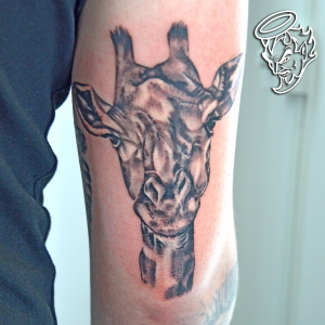 Realism Giraffe Tattoo - part of an ongoing animal themed full sleeve - by Iaint Nosaint at I Ain't No Saint near St Albans Tattoo Studio