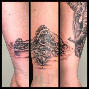 Crocodile in the water by Tattoo Artist Iaint Nosaint in the Watford Tattoo Studio I Ain't No Saint